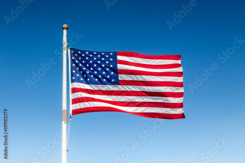 Photo  USA flag waving in the wind against blue sky on a sunny day