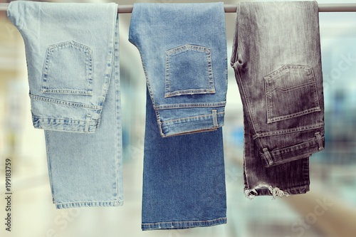Poster  Three pair of different jeans hanging