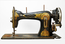 An Old Antique Sewing Machine, Decorated With Golden Ornaments