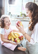 Cheerful family in a kitchen - fruit diet theme