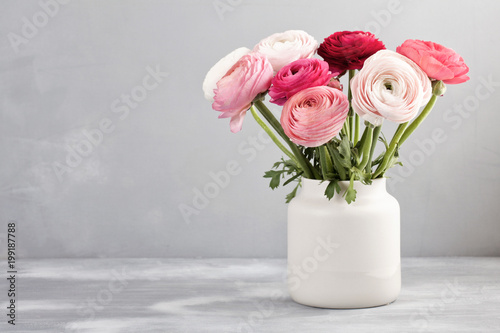 Canvas Print Bouquet of pink and white ranunculus flowers over the grey wall