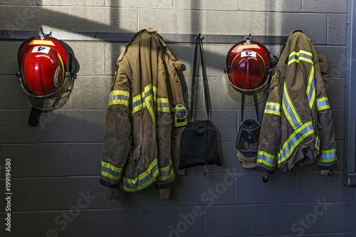 Fototapeta Firefighter helmet and uniform