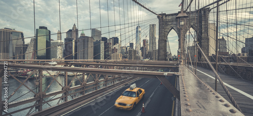 New York TAXI Famous Brooklyn Bridge with cab