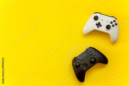 Fotografie, Tablou  Black and white joystick on yellow background