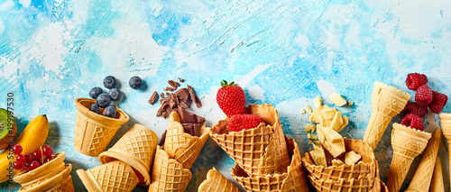 wafer-cones-filled-with-fruits-on-blue-background