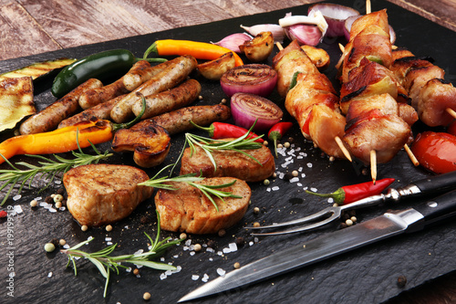 Assorted delicious grilled meat with vegetable on a barbecue