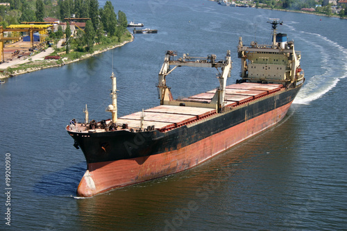 Photo Stands Ship Big cargo ship arriving in port