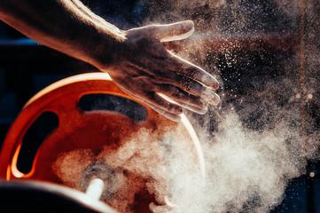 Male powerlifter hand in ta...