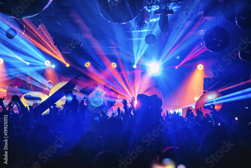 dj night club party rave with crowd in music festive Fotobehang