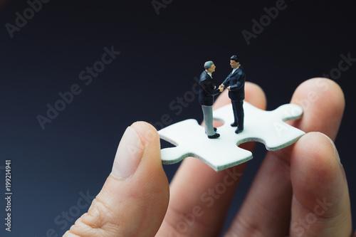 Fotografie, Obraz  Business success strategy with collaboration, teamwork or negotiation jigsaw key