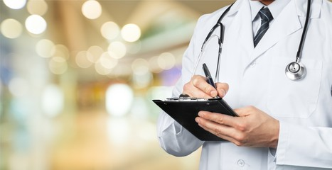 Doctor working on tablet