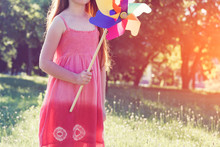 Girl With Pinwheel Toy In Park
