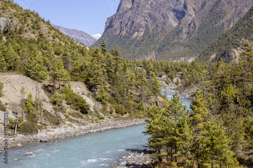 Beautiful mountain landscape in Himalayas, Annapurna region, Nepal. Big mountain, blue river and fresh air. Eco travel