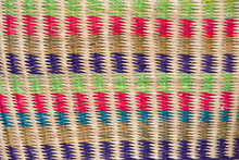 Basket Weave Background Pattern In Green, Pink, Blue, Purple And Natural Brown.