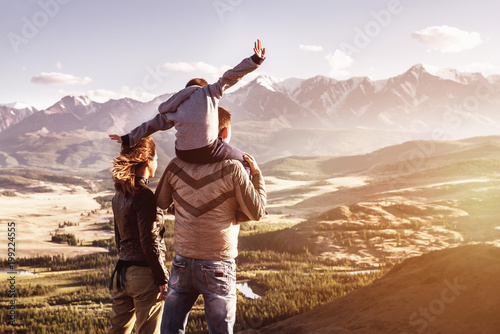 Happy family travel tourism mountains concept