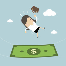 Businesswoman Falling Into A Money Banknote. Business Concept