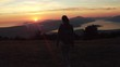 Woman successful hiking climbing silhouette in mountains, motivation and inspiration landscape on island and ocean. Hiker with arms up outstretched on mountain top looking at beautiful view.