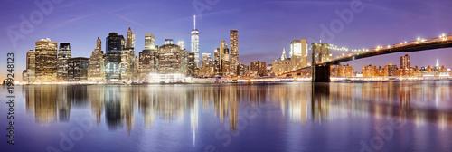 Photo  New York panorama with Brooklyn bridge at night, USA