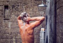 Man Showering And Washing Head