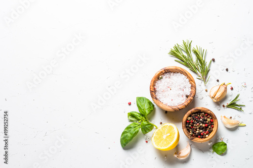Photo  Spices and herbs over white stone table top view.