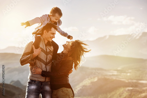 Family child walking mountains sunset