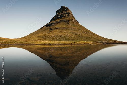 Big hill and calm lake
