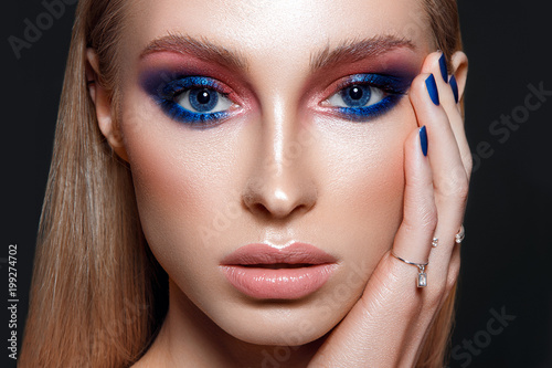 Fotografija Beautiful woman portrait with blue glamour make up and blue nails