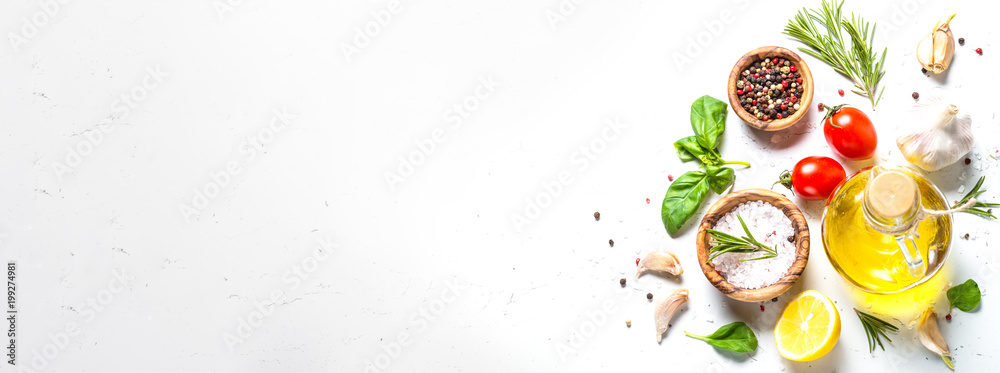Fototapety, obrazy: Spices, herbs and olive oil over white stone table.