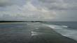 Drone shot aerial tropic beach and flat water seashore waves at tourism paradise Nusa Dua in Bali - Indonesia