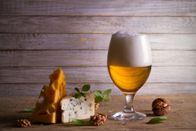 Beer And Cheese. Beer Glass On Wooden Table. Ale And Appetizer Snack. Horizontal