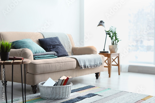 Foto  Stylish living room interior with comfortable sofa