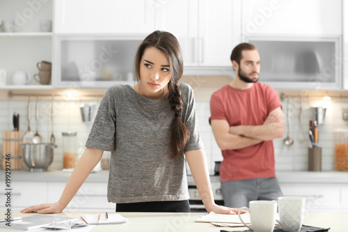 Young couple ignoring each other after having argument in kitchen Wallpaper Mural