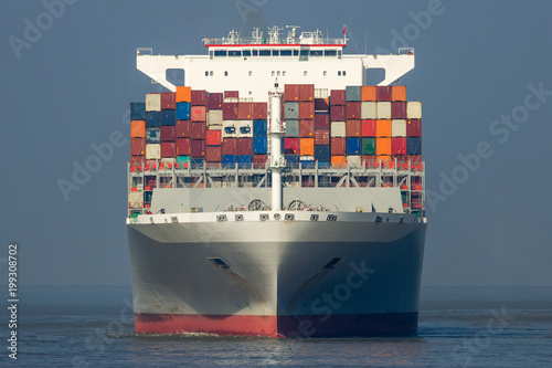Fotografie, Obraz  front view of a cargo shipping sea container ship