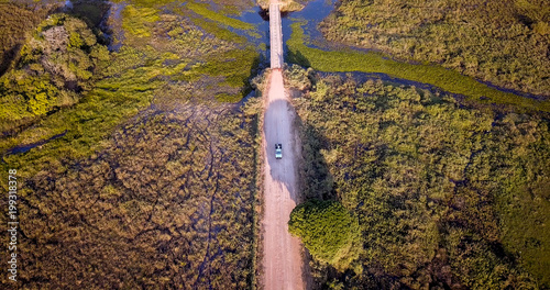 Poster Amérique du Sud Aerial view of car on the Transpantaneira road in the Pantanal wetlands.