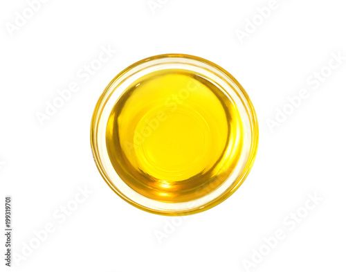 Top view of olive or sunflower yellow oil in glass bowl isolated on white background