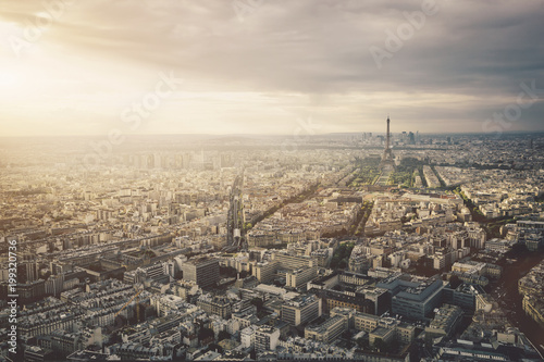 Aerial view of cityscape against cloudy sky