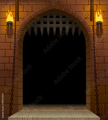 Medieval castle gate with a drawbridge and torches with a black aperture Canvas Print
