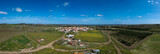 Aerial view of colorful field with a village in spring with blue sky in background. Portugal