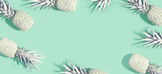 Painted pineapples on a pastel green background
