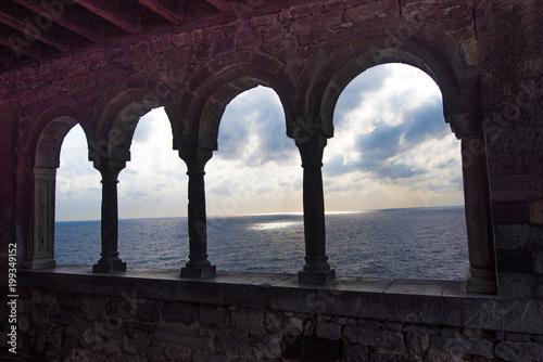 Canvas Prints Liguria magical sea view through the castle and gothic Church of St. Peter arches in Porto Venere, Liguria, Italy