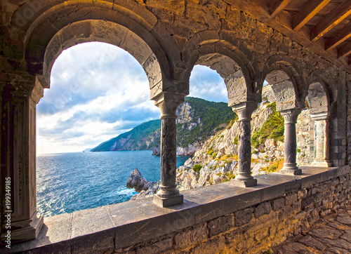Poster Cappuccino magical sea view through the castle and gothic Church of St. Peter arches in Porto Venere, Liguria, Italy