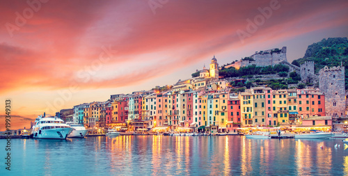 Garden Poster Liguria Mystic landscape of the harbor with colorful houses in the boats in Porto Venero, Italy, Liguria in the evening in the light of lanterns at sunset