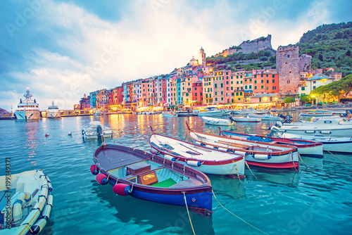 Photo Stands Blue jeans Mystic landscape of the harbor with colorful houses and the boats in Porto Venero, Italy, Liguria in the evening in the light of lanterns