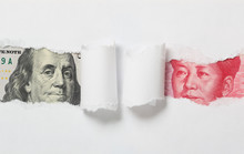 Chinese Money Note Vs US Money Note On A Teared White Paper.