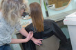 young beautiful woman having her hair cut at the hairdressers