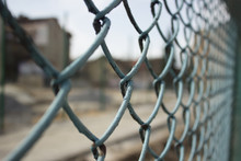Metal Fence Concept With Building Construction Yard On Background