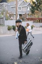 Boy In Halloween Costume Walki...