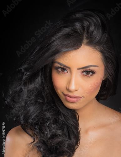 Beautiful young woman's face and long dark hair