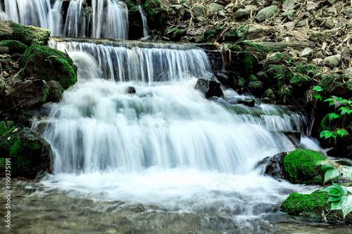 Fototapeten Wasserfalle Small forest waterfall
