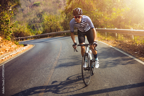 Fotografia  Asian men are cycling road bike in the morning